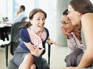Businesswomen gossiping in office. Image shot 2008. Exact date unknown.